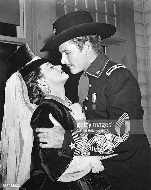 American actress Olivia de Havilland and Australian actor Errol Flynn on the set of They Died with Their Boots On directed by Raoul Walsh