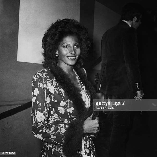 American actress Pam Grier arrives at a formal gathering, circa 1975.