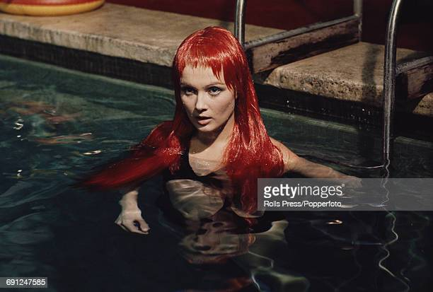 American actress Pamela Tiffin pictured wearing a swimsuit in a swimming pool in character as Gloria Bianchi during production of the Italian film...