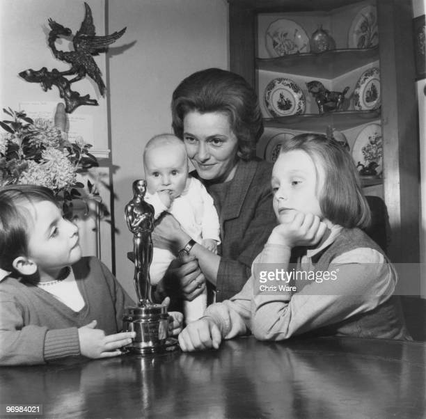 American actress Patricia Neal at home in Great Missenden Buckinghamshire with her three children and her Oscar statuette which she won for her role...