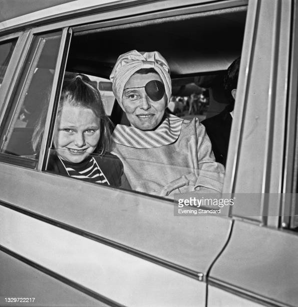 American actress Patricia Neal at London Airport , UK, with her daughter Tessa Dahl, after a flight from California, 20th May 1965. Neal is...