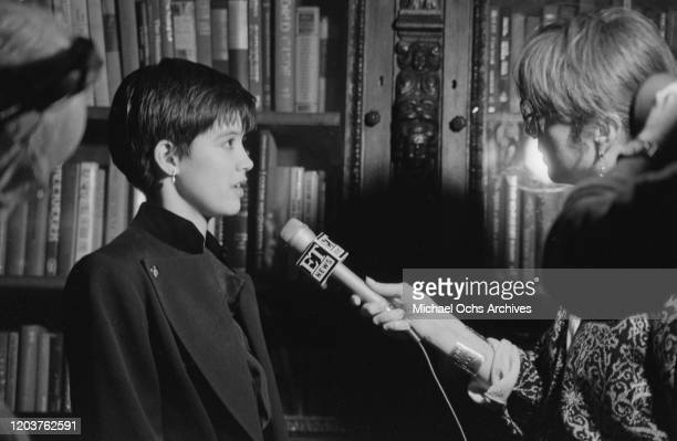 American actress Phoebe Cates speaks to an interviewer from ET News at the 'Illuminations' AIDS Benefit for the Northern Lights Alternatives at the...
