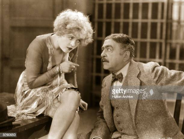 American actress Phyllis Haver formerly Phyllis O'Haver plays murderess Roxie Hart in conversation with her lawyer in the film 'Chicago' directed by...