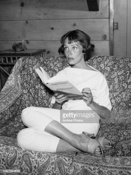 American actress Phyllis Kirk reading 'The Myth of Sisyphus and Other Essays' by Albert Camus, circa 1965.
