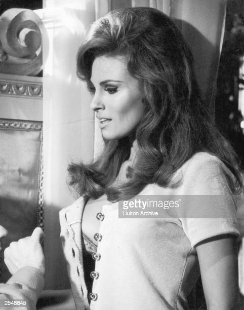 American actress Raquel Welch personifies the sin of Lust in the Dudley Moore/Peter Cook comedy 'Bedazzled' 1967 The film was directed by Stanley...