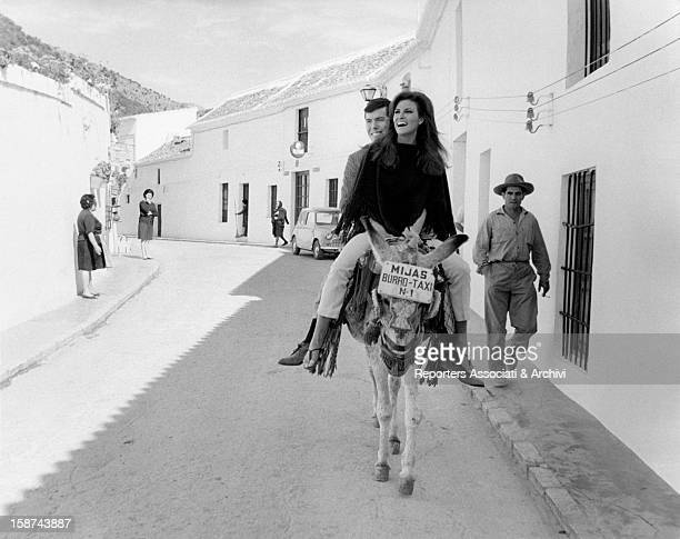 American actress Raquel Welch riding a donkey taxi with her boyfriend the American film producer Patrick Curtis She's in Spain to shoot the film...