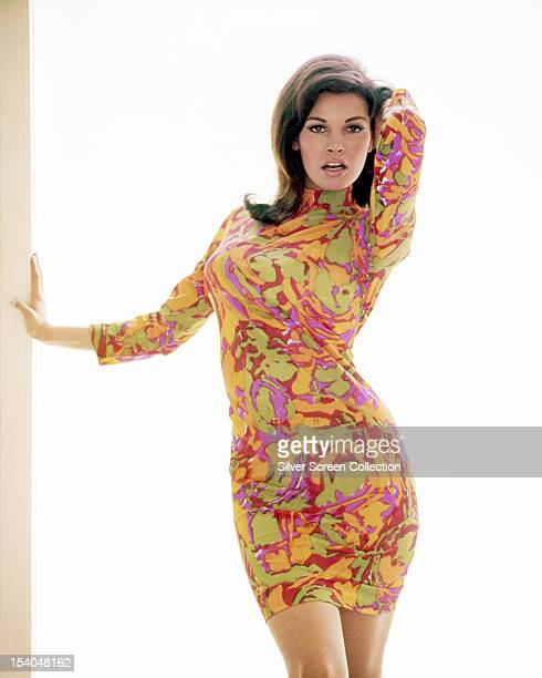 American actress Raquel Welch wearing a psychedelic dress, circa 1967.
