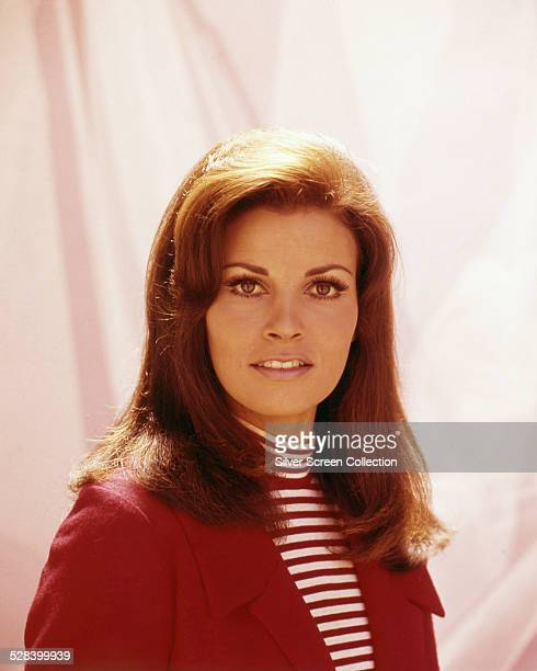 American actress Raquel Welch, wearing a red jacket over a striped top, circa 1965.