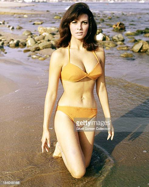 American actress Raquel Welch wearing an orange bikini in a publicity still for 'The Biggest Bundle of Them All', directed by Ken Annakin, 1968.