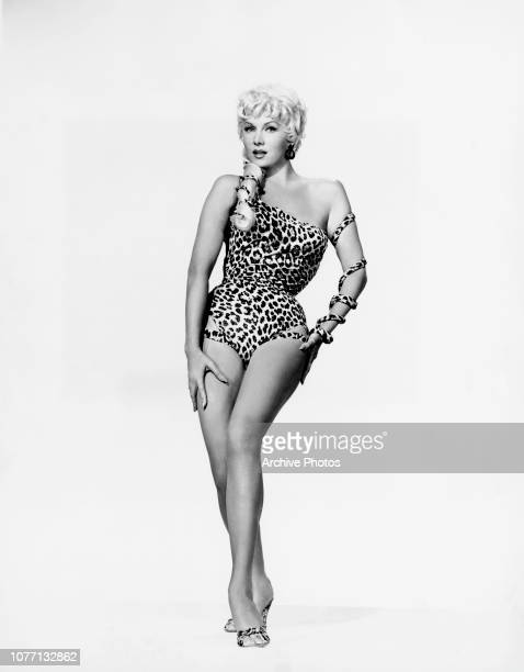 American actress Rhonda Fleming wearing a leopard print swimsuit circa 1955