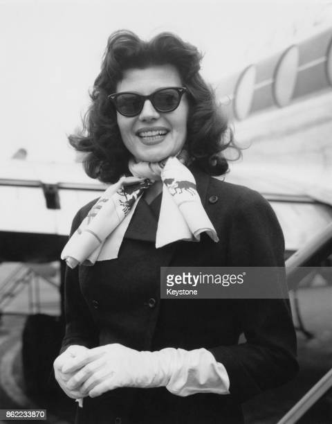 American actress Rita Hayworth flies back to Paris from London Airport after a dress fitting for her new film 'Fire Down Below' 26th April 1956