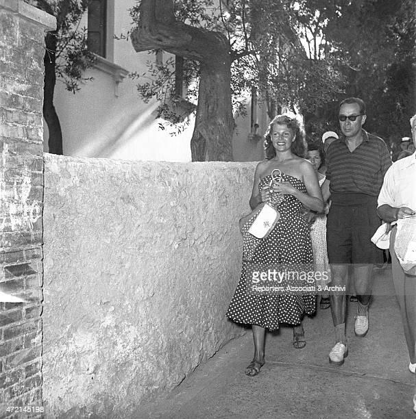 American actress Rita Hayworth walking in the lanes of Capri followed by some fans Capri 1950