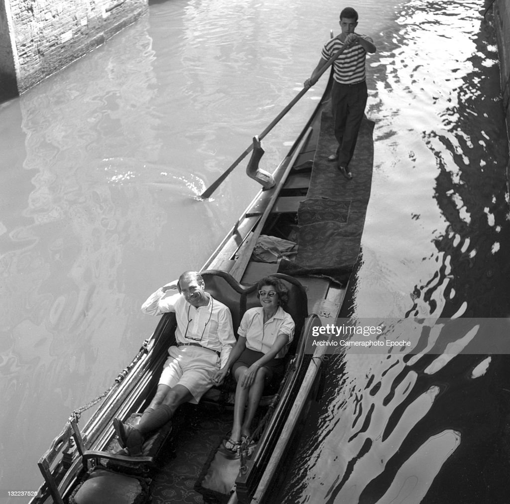 American actress Rita Hayworth with Gary Merrill having a gondola ride, Venice, 1961.