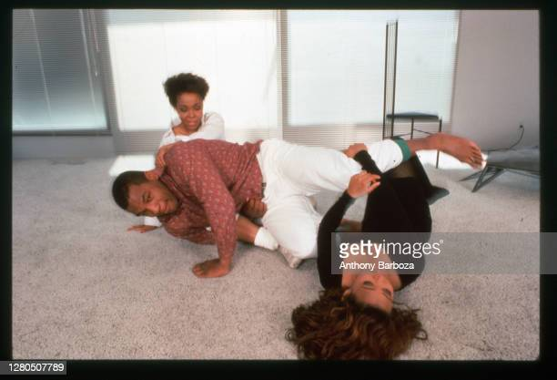 American actress Robin Givens , her husband, heavyweight boxer Mike Tyson, and her mother, Ruth, roll around on the floor of their new home, Los...