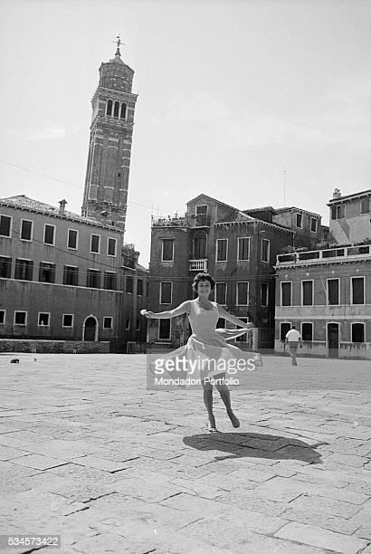 American actress Ruth Roman dancing in Campo Santo Stefano during the XVIII Venice International Film Festival Venice 1957