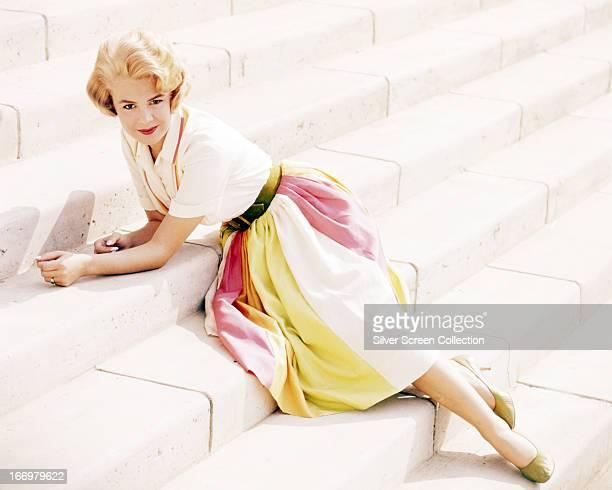 American actress Sandra Dee posing on a flight of steps circa 1962