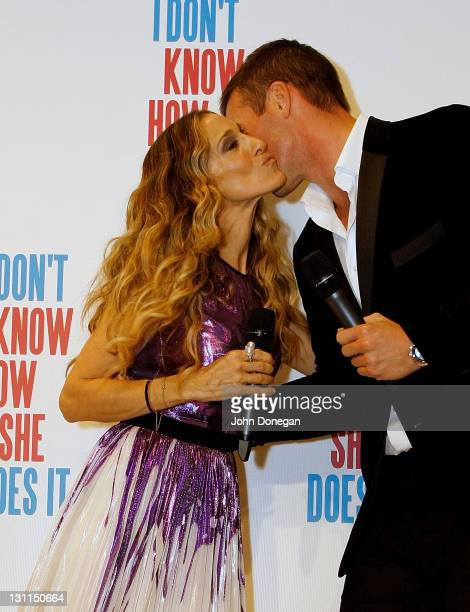 """American actress Sarah Jessica Parker kisses Kris Smith as she arrives at the Melbourne premiere of """"I Don't Know How She Does It"""" on November 2,..."""