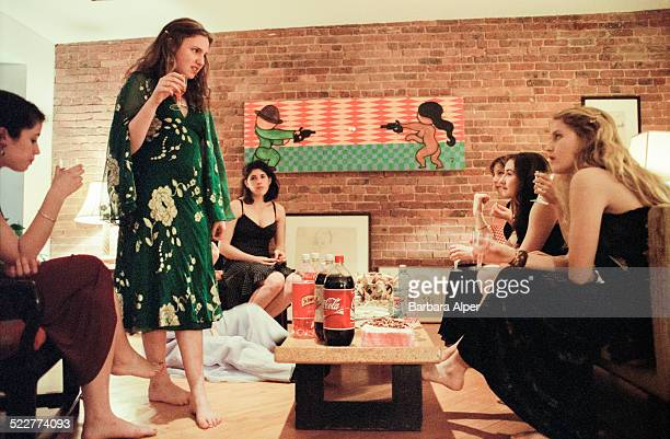 American actress screenwriter producer and director Lena Dunham standing hosts a Barefoot Formal dinner party for twelve of her girlfriends from St...