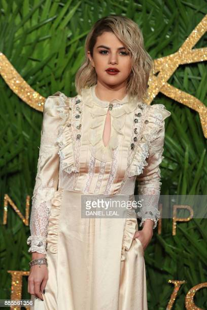 American actress Selena Gomez poses on the red carpet upon arrival to attend the British Fashion Awards 2017 in London on December 4 2017 / AFP PHOTO...