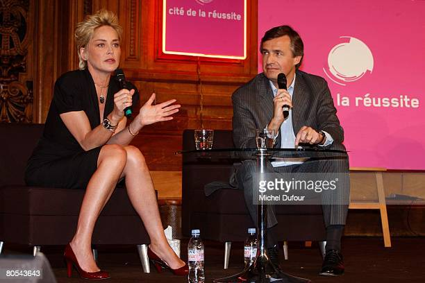 American actress Sharon Stone speaks beside Nicolas Beytout at the Cite de la Reussite at Sorbonne University on April 6, 2008 in Paris, France. The...