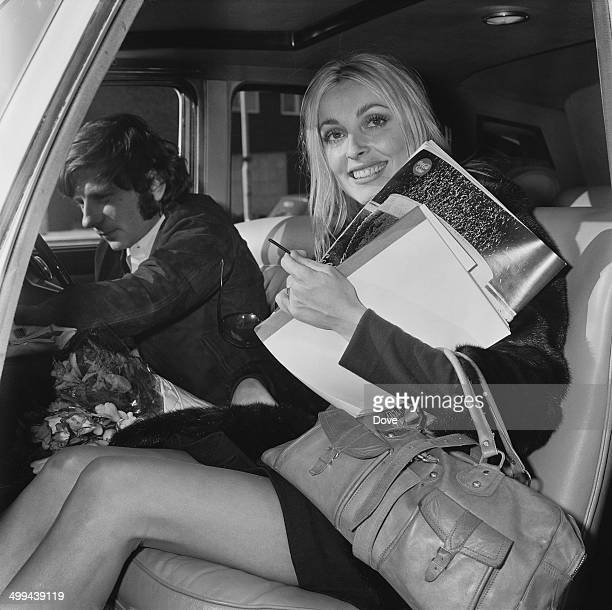 American actress Sharon Tate with her husband Polish film director Roman Polanski in a Rolls Royce at London Airport 5th April 1969