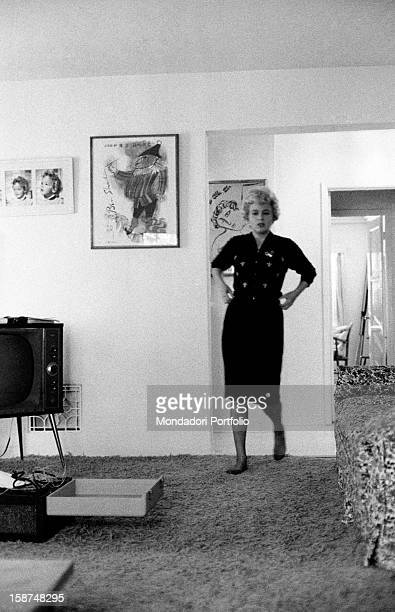 American actress Shelley Winters whose real name is Shirley Schrift walks barefoot around the rooms of her private American house Hollywood United...