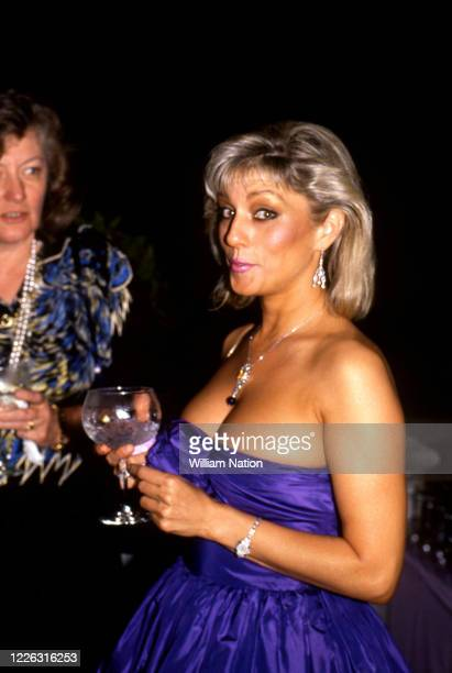 American actress Shera Danese poses for a portrait during the Women's Wear Daily party circa September, 1987 at Elizabeth Taylor's estate in Beverly...