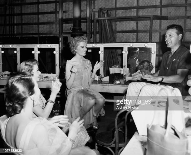 American actress Sheree North and friends play a game between takes of the 20th Century Fox musical 'The Best Things in Life Are Free' circa 1956