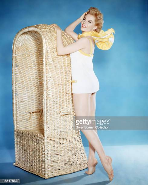 American actress Sheree North in a white one piece swimsuit circa 1955
