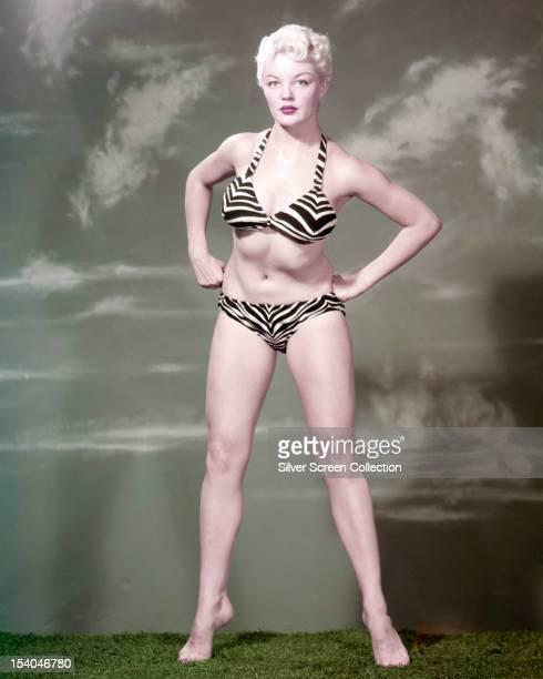 American actress Sheree North wearing a blackandwhite striped bikini circa 1955