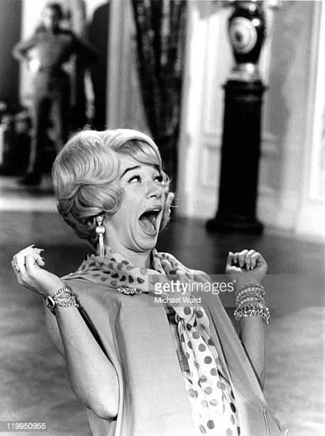 American actress Shirley MacLaine shrieks on the set of 'The Yellow Rolls Royce' MGM Studios