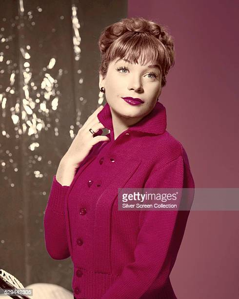 American actress Shirley MacLaine wearing a pink knitted top circa 1957