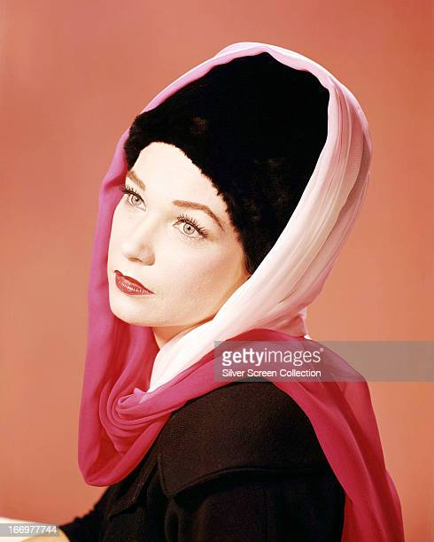 American actress Shirley MacLaine wearing silk scarves over a brimless fur hat, circa 1965.