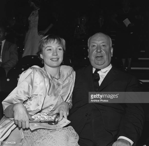 American actress Shirley MacLaine with British film director Alfred Hitchcock at an Ice Follies show on September 10 1959