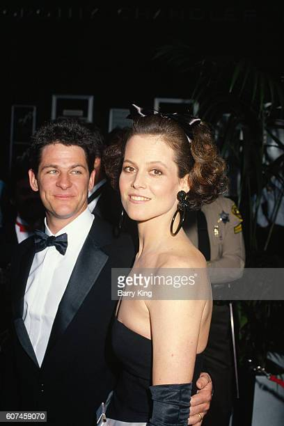 American actress Sigourney Weaver and her husband stage and film director Jim Simpson attend the 59th Academy Awards ceremony in Los Angeles