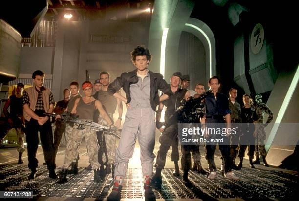American actress Sigourney Weaver surrounded by actors Paul Reiser Michael Biehn Jenette Goldstein and Lance Henriksen on the set of Alien written...