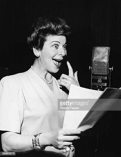 American actress singer and comedian Fanny Brice hams it up as she reads a script into a microphone as the title character a bratty toddler for an...