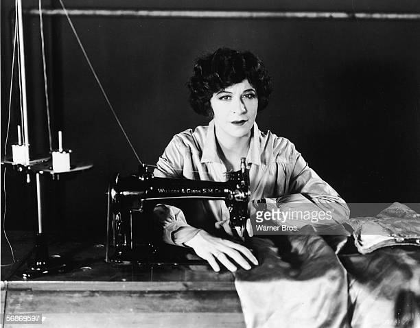 American actress singer and comedian Fanny Brice operates a Willcox Gibbs sewing machine in a publicity still for the dramatic musical film 'My Man'...