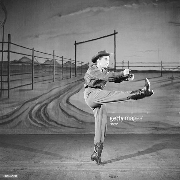 American actress singer and dancer Allyn Ann McLerie of the American Ballet Theatre dances the role of The Cowgirl in 'Rodeo' with music by Aaron...