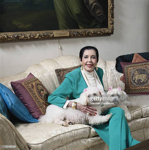 American actress singer and dancer Ann Miller at home with her pet toy poodles circa 1995
