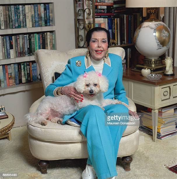 American actress, singer and dancer Ann Miller at home with her pet toy poodle, circa 1995.