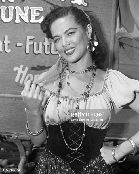 American actress singer and dancer Dona Drake dressed as a gypsy fortune teller circa 1950