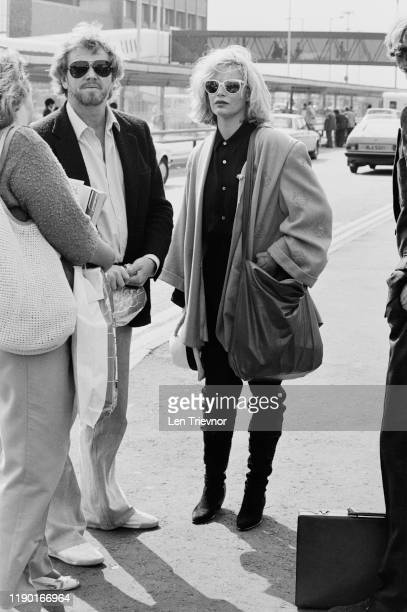 American actress singer and fashion model Kim Basinger with her husband Ron SnyderBritton at Heathrow Airport London UK 12th September 1984