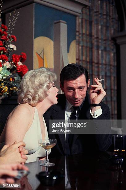 American actress singer and model Marilyn Monroe and Italianborn French actor and singer Yves Montand on the set of Let's Make Love directed by...