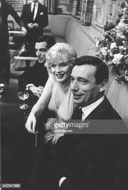 American actress, singer, and model Marilyn Monroe and Italian-born French actor and singer Yves Montand on the set of Let's Make Love, directed by George Cukor.