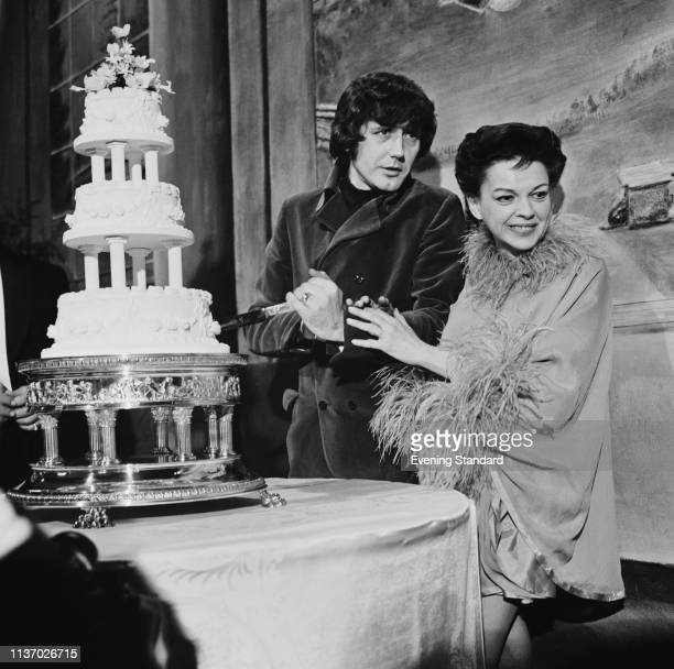 American actress singer dancer and vaudevillian Judy Garland and American musician and entrepreneur Mickey Deans cutting their wedding cake London UK...