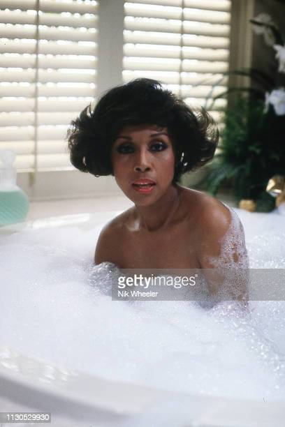 American actress singer film and television star Diahann Carroll soaks in hot tub on the set of television hit series Dynasty in Hollywood California...