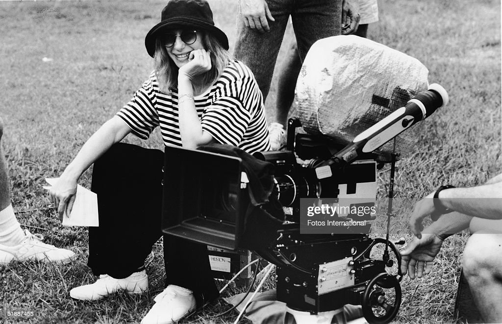 American actress, singer, film director and producer Barbra Streisand takes a break from directing a scene in 'The Prince of Tides,' 1991.