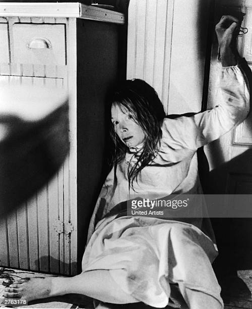 American actress Sissy Spacek cowers on the kitchen floor with wet hair in a still from the film 'Carrie' directed by Brian De Palma 1976