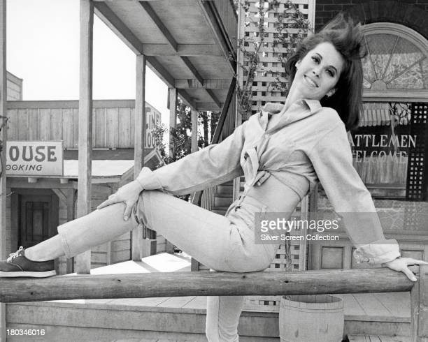 American actress Stefanie Powers posing on a western film set circa 1970